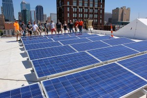 Brightergy team members installing a solar array on top of our headquarters in downtown Kansas City