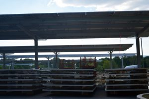 rows of solar panels ready to be installed at UMass Amherst