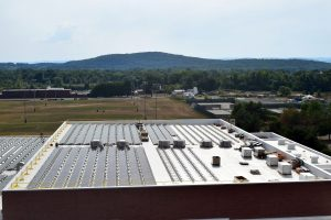 aerial view of UMass Champions Center solar array during installation