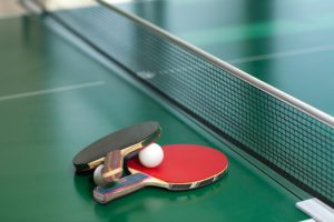 shutterstock stock image of ping pong paddles and ball on table